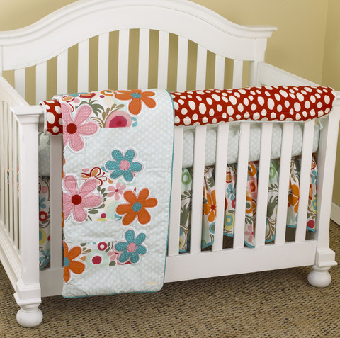 "These crib bedding sets are the same as the 3 piece set but the fourth part is the front rail cover-up, which protects the footboard on convertible cribs, but it also is a little protection for the baby. Once baby start to stand up in the crib and it could stumble against the rail and the front rail cover may just protect the baby in that stumble.  Front Rail Cover-Up Set includes: front rail cover-up (measures 51"" x 15""), crib sheet, coverlet, dust ruffle Made from 100% cotton percale"