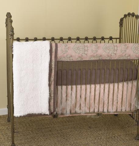 "This ""Front Rail Cover-Up"" of the crib bedding sets is a beautiful combination of soft pinks, gray and warm charcoal to adorn your princess baby girl nursery. Front Rail Cover-Up set includes: front rail cover-up (measures 51"" x 15""), fitted crib sheet, coverlet and dust ruffle."