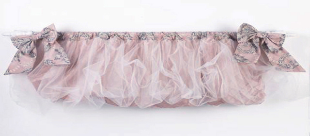 This curtain valance made in a beautiful pin tuck poly satin with double layers of champagne tulle. Two bows adorn the ends of the curtain valance. The curtain valance can be stuffed for balloon effect or left straight. The curtain valance measures 50 x 17 inches