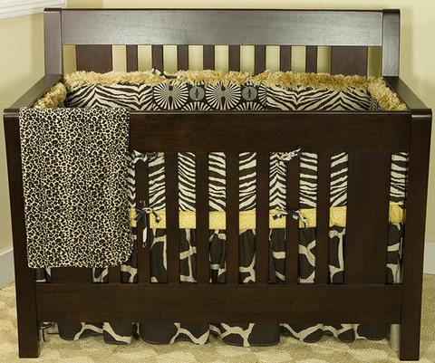 The Sumba 4pc crib bedding set is a substantial mix of superb combination of African tribal art designer fabrics, with a floral orange Masi design and faux fur accents. 4 Piece Set includes: bumper, crib sheet, coverlet and dust ruffle.  The crib Bumper comes in four sections.  Made from 100% cotton