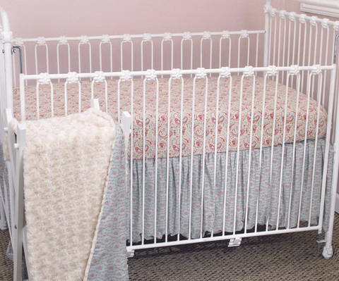 Crib bedding sets a mixture of soft vintage floriated displays and with a soft light rose faux fur coverlet.  Tea Party crib bedding sets are of great quality!