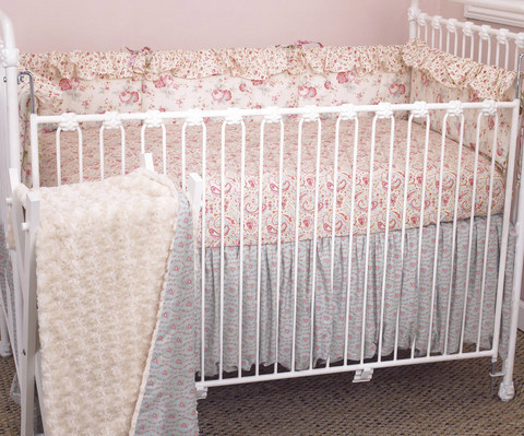 The stunning crib bedding sets are very beautiful! The colors are striking and a combination of soft vintage floral prints in pink and a dash of blue and whites with a rose faux fur coverlet. The fitted crib sheet is soft and of a lovely pink paisley pattern with lots of swirls and curls! A very pleasing look! The crib bumper is covered in a floral fabric covered with small and large roses and rosebuds.  Tea Party crib bedding sets are a great quality baby girl bedding. The items are functional and well designed to make the baby nursery a warm, cozy and most inviting room.   The 4 piece crib bedding sets include – crib bumper, fitted crib sheet, coverlet, and dust ruffle.  Made from 100% cotton and the crib bumper comes in four sections!