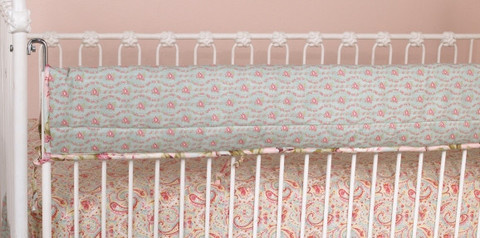 The crib bedding sets front rail cover is to protect the footboard on the convertible cribs and it also may protect the baby a little, if it should have stumbles and thump against the rail, it could be a shield!
