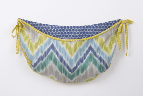 Part of the Zebra Romp crib bedding sets collection is this toy bag in chevron flame stitch with citrus trim. This toy bag is very versatile in that it can be used for toys or any nursery supplies constantly needed in a baby nursery! It can be wall decor or tied on the change-table or to a chest – but never to be hang on a baby crib.