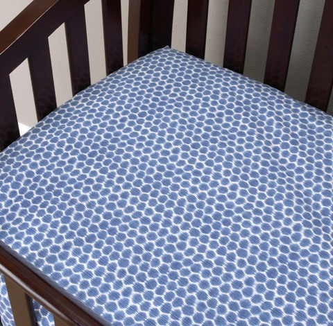 The fitted crib sheet is 250 thread count in 100% cotton and coordinates with the Zebra Romp crib bedding sets collection. Keeping your baby bedded on very soft sheets. In periwinkle blue with white hexagons! Fits standard crib mattresses!