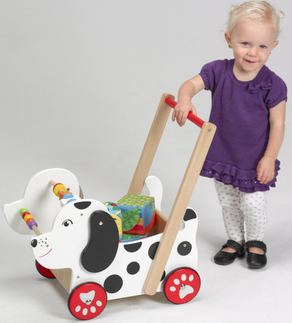 "This baby walker shaped as a lovely doggy is made of sturdy hardwood and has steel axles with rubber coated wheels.Ages 12 months + Size- Handle height 20"", 18"" L x 12"" W,  6 colored beads 9 shaped beads Light adult assembly required"