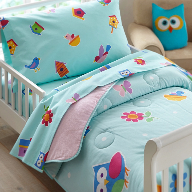 Little girls will love this fanciful comforter in the birds and flower design.The comforter/quilt is scattered with birds, flowers and birdhouses on a robins egg blue and made of the same soft 100% cotton percale as our sheets. The back is a pink cotton flannel!