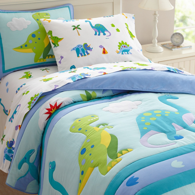 Dinosaur Land bedding is 100% ultra soft cotton percale!  Prehistoric fun! Our Dinosaur Land comforter/quilt has rows of adorable dinosaurs roaming across the bed. Children bedding at its best!