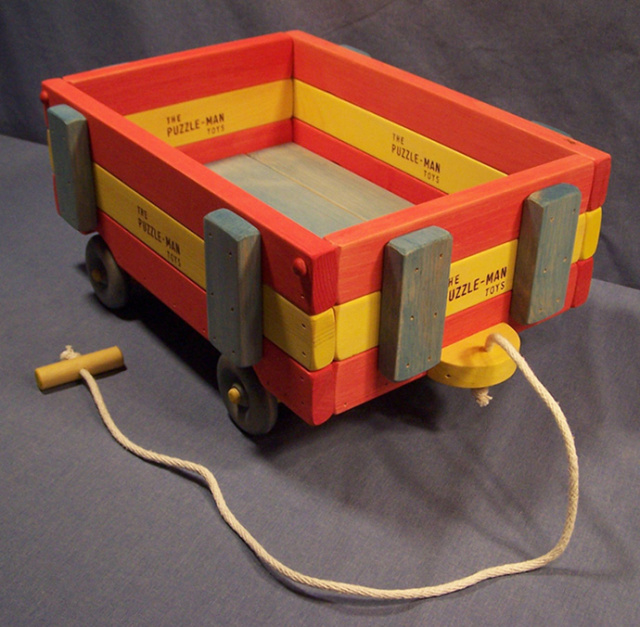 "This wooden wagon is 3 tier high and the size is 10-1/2"" wide, 20"" long, and 9"" high. Made out of solid wood and sturdy construction.  The pull cord is nylon cording. It can hold up to 75 of our educational games building blocks."